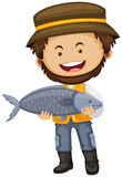 Fisherman holding big fish in hands Stock Photography