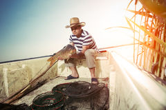 Fisherman Holding a Big Fish Stock Images