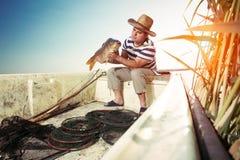 Fisherman Holding a Big Fish Stock Photo