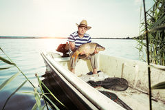 Fisherman Holding a Big Fish Royalty Free Stock Photography