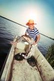 Fisherman Holding a Big Fish Stock Photography