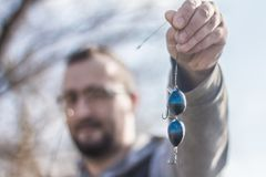 Fisherman holding a custom made hook and baits stock photos