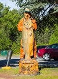 A beautifully carved statue outside the tourism building at soldotna royalty free stock photo