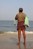A fisherman holds his fishing net Royalty Free Stock Photo