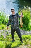 Fisherman holds in his hand  pike Stock Photo