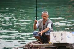 A fisherman in Hong Kong Royalty Free Stock Photos