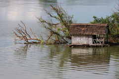 Fisherman house on Mekong river Royalty Free Stock Image