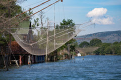 Fisherman house and net on the river in Montenegro stock photos