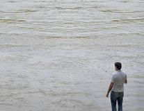Fisherman in a huge river royalty free stock image