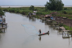 Fisherman. A fisherman is hunting fish on the boat in lake near the seaside of thailand Stock Photos