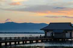Fisherman hut. A fisherman hut by the lake with an evening scene of Phayao lake Stock Photo