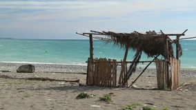 Fisherman hut on seashore stock video