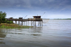 Fisherman huts on the river Stock Photography