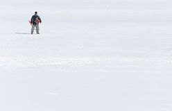 Fisherman on ice Stock Photos