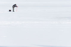 Fisherman on ice. The fisherman on an ice Stock Images