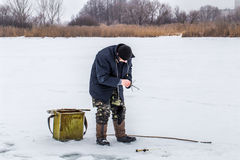A fisherman on the ice Royalty Free Stock Photography