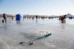 Fisherman ice screws in the foreground, fishing in Russia Stock Image
