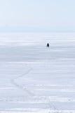 Fisherman on ice Stock Image