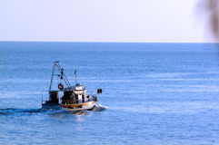 Fisherman In The Boat Royalty Free Stock Photography