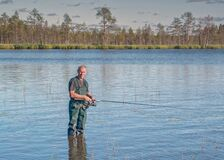 Free Fisherman In The Lake. Ecotourism, Visiting Fragile, Pristine, Undisturbed Natural Areas Active Fishing Holidays Stock Photos - 178359703