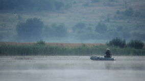 Fisherman on an inflatable boat stock video footage