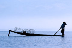 Fisherman on Inle Lake. Fisherman in Inle Lake makes a living by using a coop-like trap with net to catch fish Royalty Free Stock Image