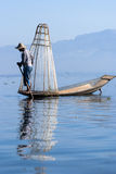 Fisherman on Inle Lake. INLE LAKE, MYANMAR - FEBRUARY 17: Fisherman catches fish for food on February 17, 2011 on Inle Lake, Myanmar. Intha people possess the Royalty Free Stock Photography