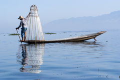 Fisherman on Inle Lake. INLE LAKE, MYANMAR - FEBRUARY 17: Fisherman catches fish for food on February 17, 2011 on Inle Lake, Myanmar. Intha people possess the Royalty Free Stock Images