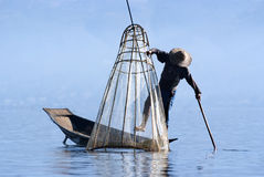 Fisherman on Inle Lake. INLE LAKE, MYANMAR - FEBRUARY 17: Fisherman catches fish for food on February 17, 2011 on Inle Lake, Myanmar. Intha people possess the Stock Photography