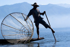 Fisherman on Inle Lake. INLE LAKE, MYANMAR - FEBRUARY 17: Fisherman catches fish for food on February 17, 2011 on Inle Lake, Myanmar. Intha people possess the Stock Images