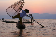 Fisherman in Inle lake. The fisherman can use leg-row-boat and catch fish in Inle Lake, Myanmar stock photo