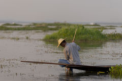 Fisherman on the Inle lake in Myanmar. A leg rowing fisherman on Inle Lake in Shan State in Myanmar (Burma).This unique style of rowing evolved because the Stock Photography