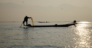 A fisherman on Inle Lake, Myanmar. A fisherman working on Inle Lake, Shan state, Myanmar. Shan State is a state of Myanmar. Shan State borders China to the north Royalty Free Stock Photos