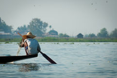 Fisherman at Inle Lake working on one foot Royalty Free Stock Images