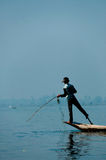 Fisherman at Inle Lake working on one foot Stock Images