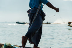 Fisherman at Inle Lake working on one foot Stock Photography