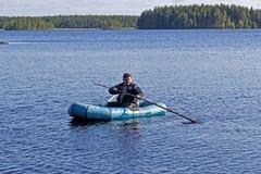 Fisherman installs the zherlitsa Royalty Free Stock Photos