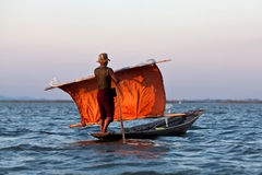 Fisherman of Intha tribe people in wooden boat Stock Photos