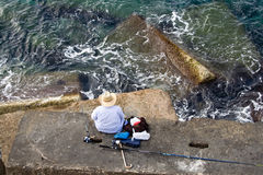Fisherman Is Fishing On The Sea Stone, Top Horizon Stock Images