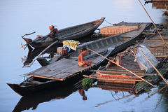 Fisherman In Kampong Cham. A fisherman sitting on his boat. They usually started to fish early in the morning. Most of them are husband and wife. They work Royalty Free Stock Photos