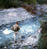Fisherman Kananaskis British Columbia Canada. A hiker in Canada's Rocky Mountains stops to fish in a glacial stream, Kootenay National Park, British Columbia Royalty Free Stock Images