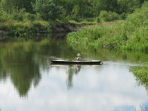 Fisherman on Kayak. View of nice river and fisherman on kayak royalty free stock photos