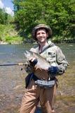 Fisherman keeps caught cherry salmon Stock Photos
