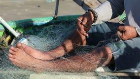 Fisherman knits a fishing net stock video