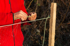 Fisherman knits fishing nets. Selective focus, copy space Stock Image