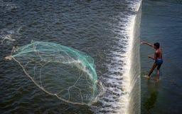 A fisherman at KR Dam near Krishnagiri throwing his cast net Stock Photography