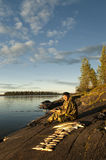 A fisherman on the lake. Stock Photography