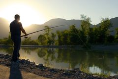 Fisherman at the lake royalty free stock photography
