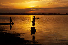 Fisherman of Lake in action when fishing, Thailand Royalty Free Stock Image