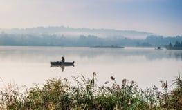 Fisherman on lake Royalty Free Stock Images